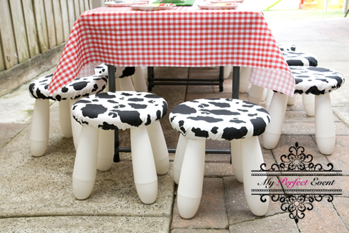 This image has an empty alt attribute; its file name is MPE_FarmThemeBirthdayPartyHire_cow-chairs.jpg